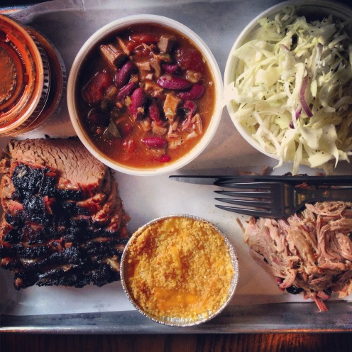 brisket and pulled pork, chili, coleslaw, and mac & cheese from Smoque BBQ