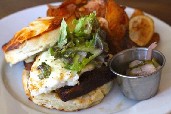 pork belly sandwich: Crispy Pork Belly, fried egg, aged cheddar, greens, charred jalapeno aioli